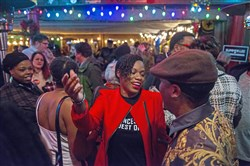 Attorney Summer Lee, center, greets supporters during her election campaign at Peppers N'AT on Monday, January 15, 2018 in Braddock.  She is running for State Representative in the 34th District.