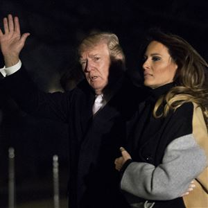 President Donald Trump with first lady Melania Trump waves as he returns to the White House in Washington, Monday, Jan. 15, 2018. Trump spent the holiday weekend at his Mar-a-Lago estate in Palm Beach, Fla.