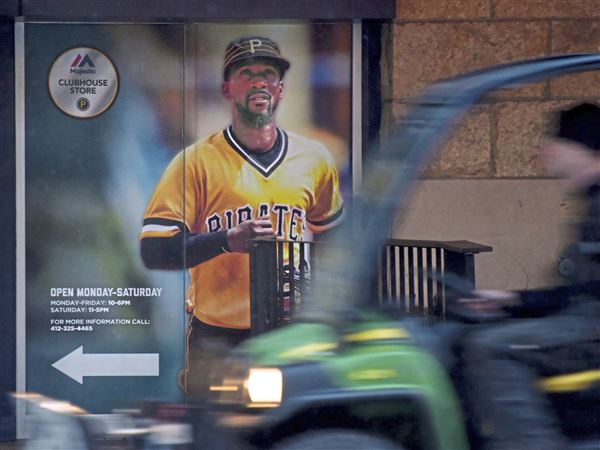 A sign feature Andrew McCutchen hangs at PNC Park's clubhouse store facing Federal Street on Tuesday.
