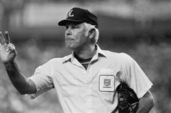 Plate umpire Doug Harvey gestures before play resumes in the fourth inning of a baseball game between the Astros and Phillies in Houston. Harvey, one of 10 umpires enshrined in the baseball Hall of Fame, died Saturday, Jan. 13, 2018. He was 87.