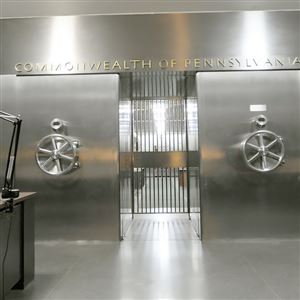 Art deco stainless steel doors welcome visitors into the entry to the main vault located beneath the Treasury building where unclaimed property is cataloged and stored in Harrisburg.