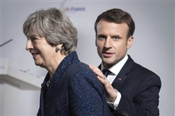 Britain's Prime Minister Theresa May and French President Emmanuel Macron during a media conference at the Royal Military Academy Sandhurst, in Camberley, England, after U.K.-France summit talks Jan. 18, 2018.