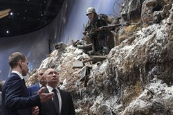 Russian President Vladimir Putin, second left, visits an exhibition of the Nevsky Pyatachok near Kirovsk to mark the 75th anniversary of the battle that broke the Siege of Leningrad outside St. Petersburg, Russia, on Jan. 18, 2018.