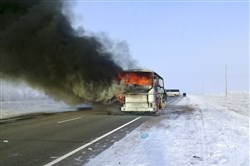 In this Kazakhstan Ministry for Emergency Situations photo made available Jan. 18, 2018, a bus burns on a road in near the village of Kalybai in Kazakhstan.