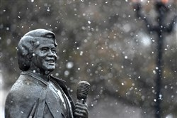 Snow gently falls around the James Brown statue during a a rare snowstorm in downtown Augusta, Ga., on the morning of Jan. 17, 2018.
