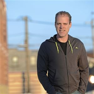 "Filmmaker Eric Chapman, a 1988 graduate of Keystone Oaks High School, stands on Murdock Street in Canonsburg. Some parts of his movie, ""Craig Quits His Day Job,"" was filmed in Canonsburg."
