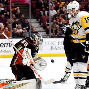 John Gibson #36 of the Anaheim Ducks makes a save in front of Riley Sheahan #15 of the Pittsburgh Penguins during at Honda Center on January 17, 2018 in Anaheim, California.