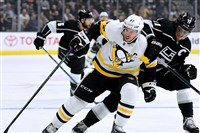 Sidney Crosby, No. 87 of the Pittsburgh Penguins and Anze Kopitar, No. 11 of the Los Angeles Kings skate for position during the first period at Staples Center on Thursday in Los Angeles, California.