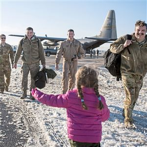 Klaire Hayden, 5, of North Fayette runs to her father Capt. Brice Hayden, center, after Hayden and others returned from deployment on a C-130 on Friday, Jan. 19, 2018, at the 911th Airlift Wing in Coraopolis. Four C-130 aircrafts returned from a four-month deployment to Qatar, the aircrafts' last deployment from Pittsburgh.