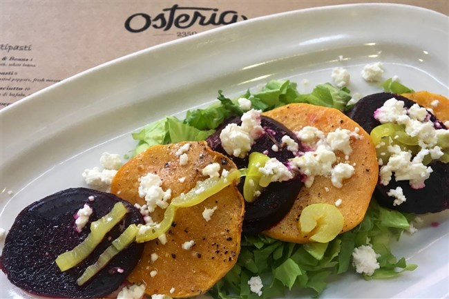 Winter squash and beet salad with feta and pickled peppers is part of the first course at Osteria 2350.