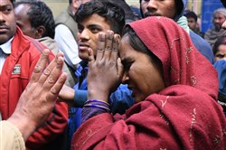 Relatives of dead and injured victims from a plastic factory fire react inside a hopital at Bawana, on the outskirts of New Delhi, on January 20, 2018.