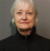 Marilyn Hartman, 66, was arrested after getting onto an airplane at O'Hare without a ticket and flying to London, according to police.