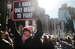 Thousands of men and women hold signs and rally while attending the Women's March on January 20, 2018 in New York.