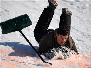 After a slow start, a few barrel rolls, and a jog down the hill, Thomas Allen, 14, from Brighton, leaps over the finish line with his shovel at Beaver County's 55th Annual Snow Shovel Race on Saturday, Jan 20, 2018 at Old Economy Park in Baden. (Haley Nelson/Post-Gazette)