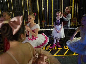 Scarlett Starkey, 11, third from right, waits backstage to perform as her teacher Dawn Kelly, both of Cincinnati, fixes her hair, before Starkey dances in the pre-competitive classical competition during the Youth America Grand Prix regional semi-finals Thursday, Jan. 18, 2018, at Upper St. Clair High School in Upper St. Clair. (Rebecca Droke/Post-Gazette)