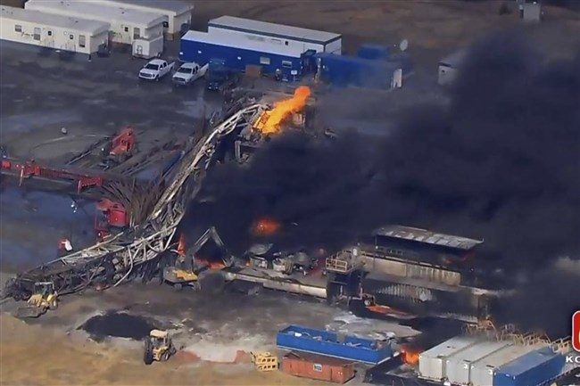 In this photo provided from a frame grab from Tulsa's KOTV/NewsOn6.com, fires burn at an eastern Oklahoma drilling rig near Quinton, Okla., on Jan. 22, 2018.