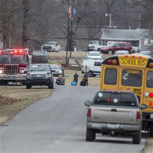 Emergency crews respond to Marshall County High School after a fatal school shooting Tuesday in Benton, Ky. Authorities said a shooting suspect was in custody.