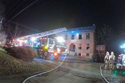 One firefighter required treatment during a fire at a vacant house in Irwin late Tuesday night.