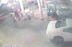 This surveillance photo from a Sunoco gas station at 7701 Penn Avenue shows Martell Smith, 41, about to buy a gallon container of gasoline; he then filled the container about 10 minutes before a fire was set at 7634 Bennett St. on Dec. 20, killing a 4-year-old girl, her mother and another woman, according to the Allegheny County District Attorney's office.