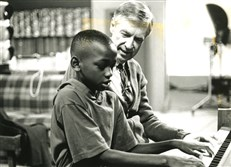Fred Rogers with Adrian Montgomery, sharing their interest in music during a break from taping in 1995.