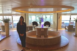 This Jan. 4, 2018, photo shows Eva Santiago, a crew member on Seabourn Sojourn, on a tour of the ship in the port of Miami.