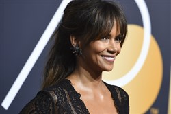 In this file photo, Halle Berry arrives at the 75th annual Golden Globe Awards at the Beverly Hilton Hotel on Jan. 7, 2018, in Beverly Hills, Calif.