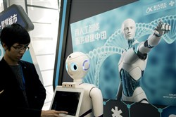 This file photo shows an iFlyTek robot that uses artificial intelligence in Beijing on Nov. 9, 2017. In the summer, China unveiled a plan to become the world's leader in artificial intelligence, challenging the longtime role of the United States.