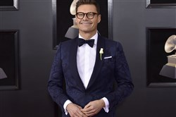 In this Jan. 28, 2018, file photo, Ryan Seacrest arrives at the 60th annual Grammy Awards at Madison Square Garden in New York.