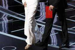 "In this file photo, Warren Beatty carries an envelope reading ""Actress in a Leading Role"" as he walks on stage with Faye Dunaway to present the Oscar for Best Picture during the 89th Academy Awards at the Dolby Theatre in Los Angeles on Feb. 26, 2017."