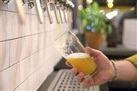 """Ian Warner, taproom manager, pours a glass of their brand new double IPA """"Orbital Convoy"""" at the Dancing Gnome Beer, as part of the Distinction Series, on Thursday, Feb. 1, 2018 in Sharpsburg. (Antonella Crescimbeni/Post-Gazette)"""
