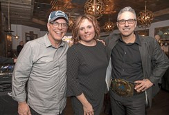 John Chamberlin, left, Rachael Rennebeck and Frank Murgia pose for a portrait during the celebration of the podcast's 100th episode Thursday at The Foundry on the North Shore.