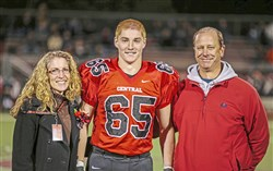 This Oct. 31, 2014, photo shows Timothy Piazza with his parents, Evelyn and James Piazza, during Hunterdon Central Regional High School football's Senior Night in Flemington, N.J.   (Patrick Carns via AP)