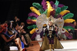 Jack Spittler III, a member of the royal court, walks for the audience at the Little Rascals Mardi Gras Ball in Kenner, La., on Jan. 25