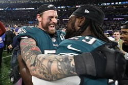 Chris Long, left, and LeGarrette Blount of the Philadelphia Eagles celebrate their 41-33 victory Sunday against the New England Patriots in the 2018 Super Bowl at U.S. Bank Stadium in Minneapolis.