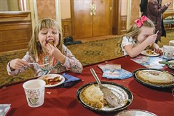 "Ainsley Christof, 4, left, of Pittsburgh, and Camlyn Reace, 5, of Gibsonia, eat pie at the Benedum Center Monday, when it was announced that they had been chosen to play the role of Lulu, the main character's daughter, for the Pittsburgh portion of the national tour of ""Waitress."""