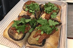 The Vernor Vegan pizza at the Michigan & Trumbull booth in Smallman Galley is topped with eggplant, romesco sauce and cilantro.