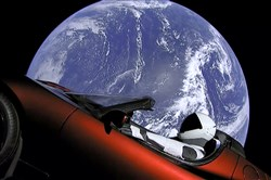 This image from video provided by SpaceX shows the company's spacesuit in Elon Musk's red Tesla sports car, which was launched into space during the first test flight of the Falcon Heavy rocket Feb. 6, 2018.
