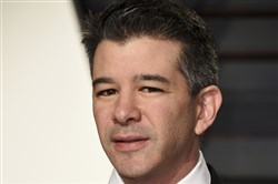 In this Feb. 26, 2017, file photo, then-Uber CEO Travis Kalanick arrives at the Vanity Fair Oscar Party in Beverly Hills, Calif.
