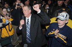 Former West Virginia head football coach Bill Stewart, center, and son Blaine, right, in 2008.