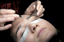 Allyson Bosser of Oakmont receives eyelash extensions at  Manikure studio in Lawrenceville.