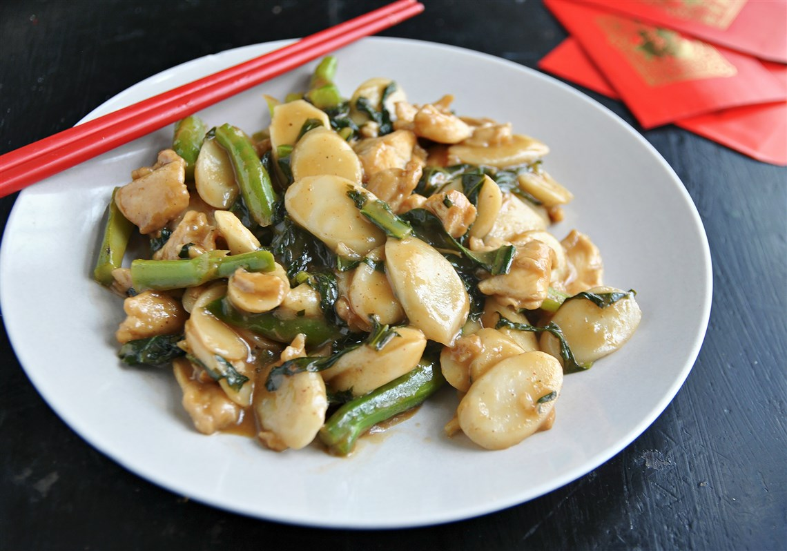 Chinese new year soul food is filled with comfort and symbolism stir fried rice cake with chicken and chinese broccoli buycottarizona Images