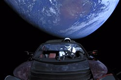 "In this handout photo provided by SpaceX on Feb. 8, 2018, a Tesla roadster launched from the Falcon Heavy rocket with a dummy driver named ""Starman"" heads toward Mars."