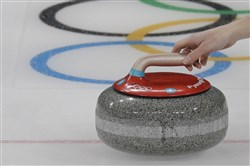 Canada's Kaitlyn Lawes releases the stone beside the olympics logo during their mixed doubles curling match against Norway at the 2018 Winter Olympics in Gangneung, South Korea, Thursday, Feb. 8, 2018.