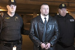 Ray Shetler Jr. is flanked by Sgt. Scott Pfeifer, left, and Westmoreland County Sheriff's Deputy Bill Lane, right, as he enters the Westmoreland County Courthouse on Thursday for the opening of his first-degree murder trial. He is accused of killing St. Clair police Officer Lloyd Reed, a 25-year veteran, who responded to a domestic dispute in 2015 in New Florence.