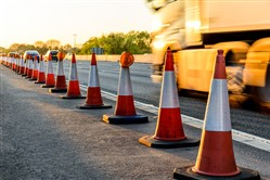 Construction cones on a highway road