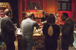 Guests enjoy food from Bigham's Tavern at the 2015 History Uncorked event at the Heinz History Center.