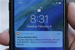In this Feb. 8, 2018, photo, Jeremy DaRos shows the erroneous tsunami alert he received on his phone Feb. 6, 2018, in Portland, Maine.