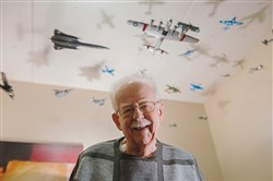 Norman Amper, 87, a resident in the Lighthouse Point Villages at Chapel Harbor, makes model airplanes that hang from the ceiling of his workshop in his condo In O'Hara.