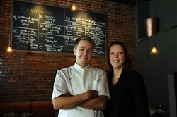 Chris and Jennifer Bonfili at their restaurant, Avenue B on Centre Avenue, in 2010.