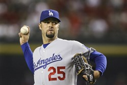 Former Pirates pitcher Esteban Loaiza has been arrested in California on suspicion of smuggling cocaine and heroin.